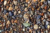 stock photo of rough-water  - Wet pebbles on the riverside as a background - JPG