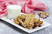 stock photo of oats  - Muesli Bars on plate with nuts and dried fruits - JPG