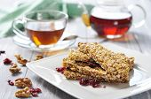 stock photo of roughage  - Muesli Bars on plate with nuts and dried fruits - JPG