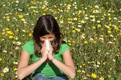 image of hay fever  - child with cold flu or hay fever blowing nose - JPG