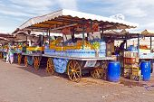 foto of stall  - Market stall with fruits on the Aa el Fna square and market place in Marrakesh - JPG
