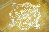 stock photo of kolam  - a rangoli art drawn on a floor which shows the culture and tradition in tamilnadu india - JPG