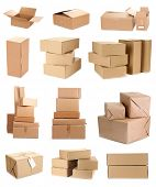 stock photo of crate  - Cardboard boxes isolated on white - JPG