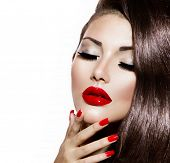 Sexy Beauty Girl with Red Lips and Nails. Provocative Make up. Luxury Woman with Blue Eyes. Fashion