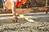stock photo of trowel  - Pouring a foundation for a new commercial building in Roseburg Oregon - JPG