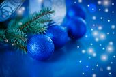 stock photo of bump  - Christmas balls and Christmas tree branch on a blue background - JPG
