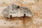 image of rock carving  - Old street sign carved into rock on the city wall of Saint Paul de Vence Franc - JPG
