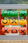 foto of tic-tac-toe  - tac tic toe game set in playground - JPG