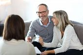 foto of retirement age  - Senior couple meeting financial adviser for investment - JPG