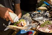 picture of gyro  - Cooking Greek gyros at the Farmers Market. ** Note: Shallow depth of field - JPG