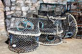 picture of lobster trap  - Lobster traps and crab pots at a dock in Brixham - JPG