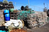 image of trap  - Lobster traps and crab pots at a dock in Brixham - JPG