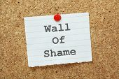 stock photo of shame  - The phrase Wall of Shame typed on a piece of paper and pinned to a cork notice board - JPG