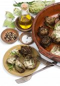 stock photo of artichoke hearts  - Artichoke hearts on big dish served with olive oil pepper and salt isolated on white - JPG