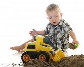 pic of bulldozer  - A young preschooler playing in sand with a toy scoop and bulldozer - JPG