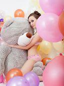 pic of flirtatious  - Image of sexy slender brunette hugging big teddy bear - JPG