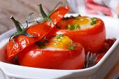 image of quail egg  - Tasty appetizer of baked tomatoes stuffed with eggs and vegetables - JPG