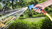 stock photo of sprinkler  - Woman - JPG
