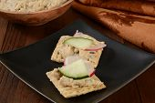 stock photo of radish  - Crackers with hummus radish and cucumber served as an appetizer - JPG