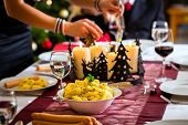 foto of wieners  - Family celebrating Christmas eve with traditional dinner Wiener sausages and potato salad - JPG