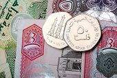 stock photo of dirham  - close up of 50 fils coins and dirham notes - JPG