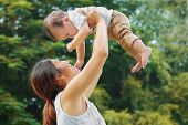 pic of kiddy  - Asian family Mother holding her baby was laughing in park - JPG