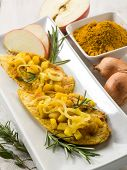 stock photo of indian apple  - escalope with apple onions and curry - JPG