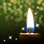 picture of candle flame  - Burning candle on abstract green color background - JPG