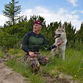 picture of wolf-dog  - Man and his purebred Czechoslovakian wolf dog - JPG