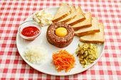 picture of yolk  - tartare meat with egg yolk - JPG