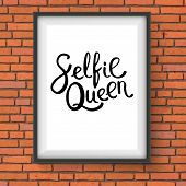 stock photo of memento  - Selfie Queen Phrase in Simple Black Text Style in a Rectangular Photo Frame Hanging on a Brick Wall - JPG
