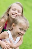 picture of three sisters  - Playing sister and younger brother on the lawn - JPG
