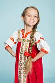 stock photo of scythe  - Blond girl with a scythe in the traditional Russian folk costume - JPG
