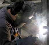 picture of pipe-welding  - Welder with protective mask welding metal and sparks - JPG