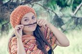 image of moustache  - Beautiful girl with hairdo putting braid - JPG