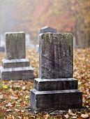 stock photo of graveyard  - Tombstone and graves in an ancient church graveyard - JPG