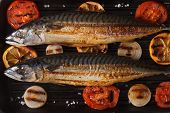 foto of grill  - Grilled mackerel fish and vegetables on the grill close up - JPG