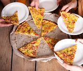 stock photo of take out pizza  - Friends hands taking slices of pizza - JPG
