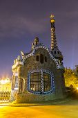 stock photo of gaudi barcelona  - Park Guell in Barcelona Spain in a summer night - JPG