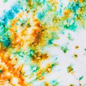 stock photo of batik  - abstract stains of batik painted on white silk close up - JPG