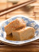 image of fermentation  - close up of a bowl of chili fermented bean curd tofu