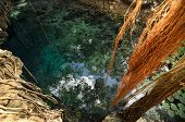 image of cenote  - Aerial view to turquoise water lagoon in X - JPG