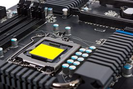 foto of cpu  - Multiphase power system modern processor with heatsink and the CPU socket - JPG