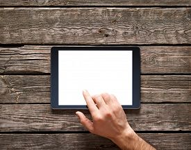 picture of touching  - Man is going to touch screen of digital tablet - JPG