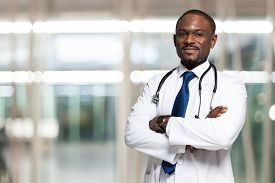 image of trustworthiness  - Portrait of an handsome smiling doctor - JPG
