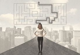 pic of women rights  - Business woman looking at road with maze and solution concept - JPG