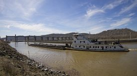 stock photo of coal barge  - Barge with Coal Entering Lock on River - JPG
