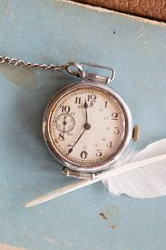 image of politeness  - Retro background old watches on a blue background and feather vintage - JPG