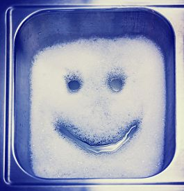 picture of detergent  -  Detergent or soap bubbles and water in the shape of a smiley face in a sink toned with a retro vintage instagram filter effect app or action - JPG