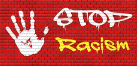 stock photo of gender  - no racism stop discrimination based on race religion gender or sexuality equal opportunity equal rights graffiti on red brick wall - JPG